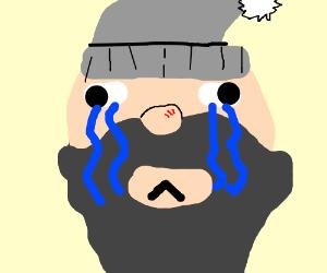 A homeless man crying