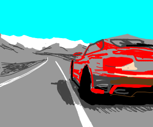 A red car driving on a road