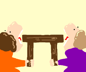 Two people eating a wooden table