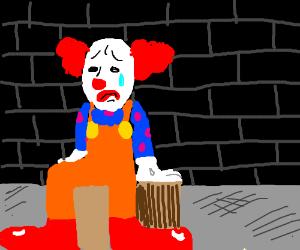 Sad clown cries while contemplating life
