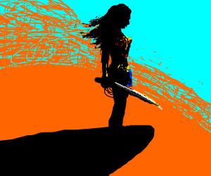 wonderwoman on a cliff with orange sky