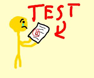 A yellow man is sad that he got a B on a test