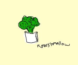 Marshmallow with broccoli stuck in it