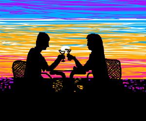 Couple having a romantic dinner.Sunset,seaside