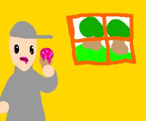 Man eats ice cream staring out floor window