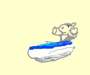 Happy baby hippo takes a bath
