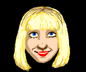 The head of a happy blonde lady.