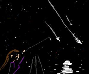women looking through telescope
