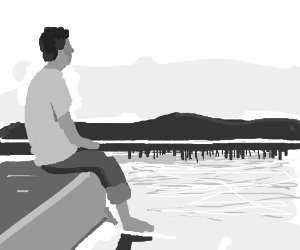 man sits on the edge of a dock,thinking