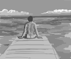 Man sitting at the end of a dock