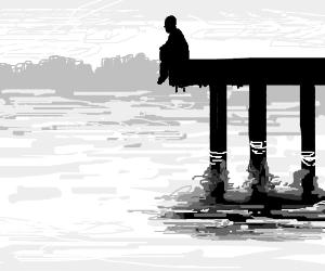 Man sittting on the pier