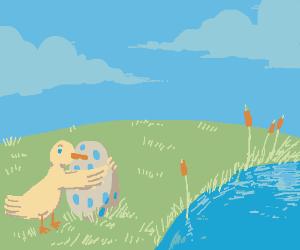a duck hugging an egg