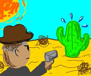 Man aiming gun at cactus