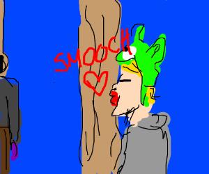 Logan Paul kissing a tree