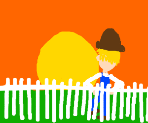 Cowboy leans on a fence watches the sunset