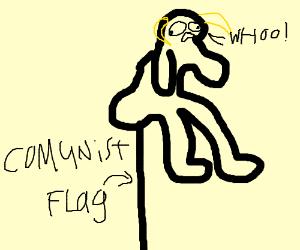 gorrilla-goat sitting on top of a flagpole