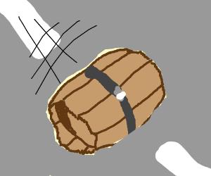 Barrel rolling down a road