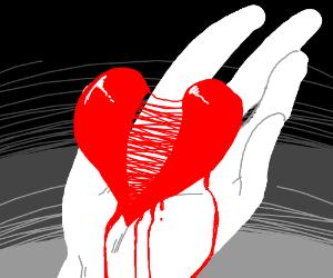 broken hand holding heart