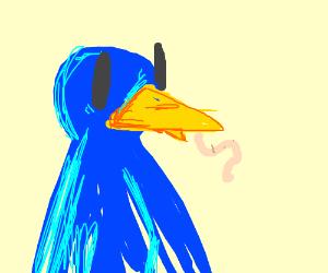 bird eating a worm