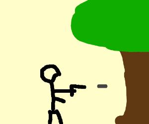 man shooting a tree
