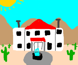a mansion in middle of the desert