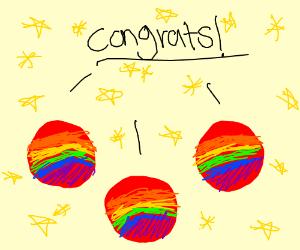 Rainbow colored balls congratulate someone