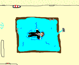 business man laying in an indoor pool