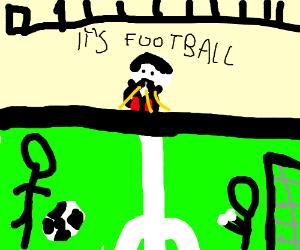 Umpire whistles during soccer game