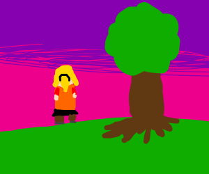 girl in orange shirt standing next to a tree