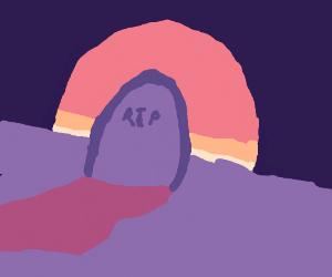 a single gravestone at sunset