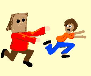 Baghead chasing man