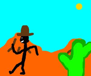 cowboy in desert talks to cactus