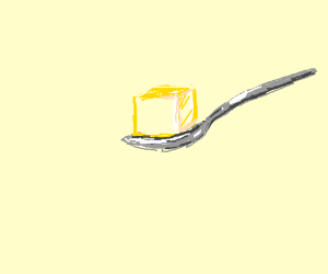 Big spoon holding a cube of butter