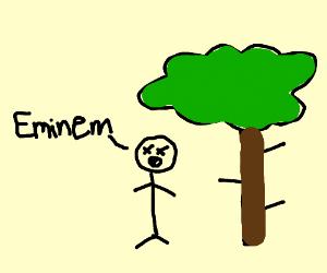 Blind Eminem stands under tree