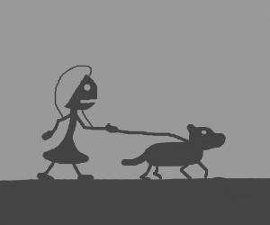 Kid walking a dog
