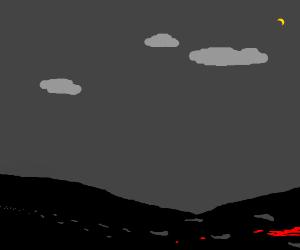 Black ground, grey sky, and a bit of lava