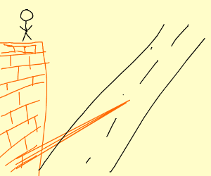 man on ledge of building on lone street