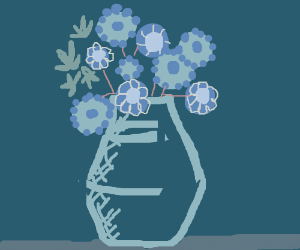 Blue vase with blue flowers in it